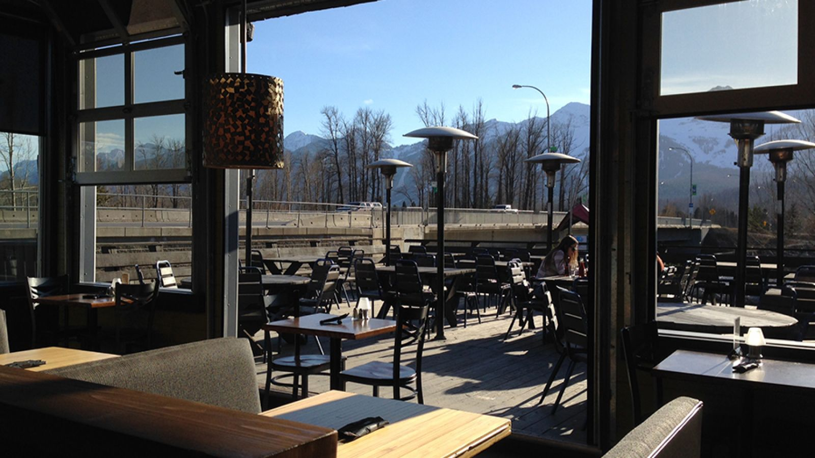 On sunny days, the overhead doors are opened to the patio.